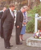 Bipartisan approach: Prime Minister John Howard, Opposition leader Kim Beazley and Democrats' leader Cheryl Kernot lay a wreath at the cafe at Port Arthur on May 1, 1996.