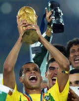 Rivaldo lifts the trophy after Brazil's 2002 World Cup triumph.