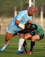 Twilight years of his career: Jonah Lomu is tackled by Montmelian's Guillaume Cognard, during their Federale One rugby union match between Marseille-Vitrolles, his new club, and Montmelian, in Vitrolles, in 2009.