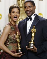 Halle Berry and Denzel Washington with the Oscars they both won at the Academy Awards in 2002.