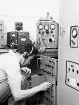 CCSIRO officers listen to the radio signals of Russian satellite, Sputnik I, at Sydney University, 7 October 1957.