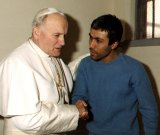 Pope John Paul meets Mehmet Ali Agca who  tried to assassinate him.