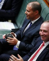 Energy and Environment Minister Josh Frydenberg gets his turn with the lump of coal in question time next to Deputy Prime Minister Barnaby Joyce.