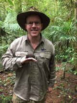 QUT's Dr Andrew Baker with a threatened Black-tailed Antechinus.