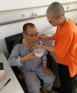 In this undated handout photo,  Liu Xiaobo, left, attended to by his wife Liu Xia in a hospital in China. Liu Xiaobo was released from prison on medical parole after being diagnosed with late-stage liver cancer. But he was not allowed to leave the country to get medical treatment in the West.