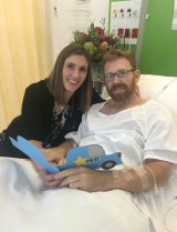 Acting Sergeant Luke Warburton, pictured with his wife Sandra, almost died when he was shot in the femoral artery at Nepean Hospital in January 2016.
