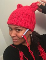 Crystal Howard of New York, showing off the pussy hat.