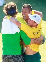 Group hug: Thanasi Kokkinakis, Nick Kyrgios and Lleyton Hewitt.