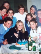 Bee Alexander, far left in middle row, at a surprise party for Katrina Dawson who is cutting the cake on her 15th or 16th birthday.