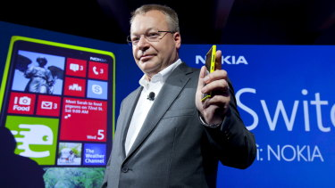 Nokia chief executive Stephen Elop with the company's smartphones, which run on Microsoft Windows Phone.