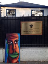 The self-portrait outside the Indonesian embassy in Santiago, Chile.