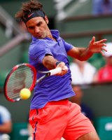 Roger Federer in action during his win over Alejandro Falla of Colombia on day one of the 2015 French Open at Roland Garros.