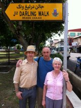 In Malaysia in 2012 with Mary and brother Tom in a street named after his grandfather Tommy Darling, a member of the British Colonial Service.