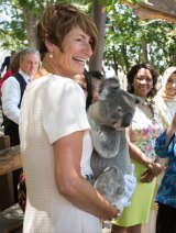 Margie Abbott, wife of  Tony Abbott, holds a koala on a spouse visit to Lone Pine Sanctuary.