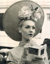 At the 1964 Melbourne Cup at Flemington, Margaret Wood of Essendon looks thoughful in her skimmer, highlighted by roses.