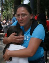 A woman hugs a child outside a school in the Roma Norte neighbourhood of Mexico City, after Tuesday's earthquake .