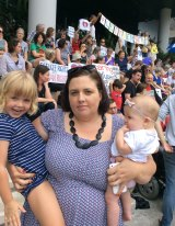 Kelly Daniels of Beenleigh, with her two children, was among the supporters showing solidarity with doctors' decision not to release a baby back to off-shore detention.