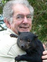 Bruce Englefield with a Tasmanian devil joey.