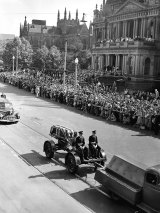Thousands line George Street, Town Hall to see the procession.