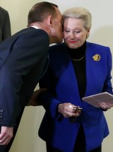 Prime Minister Tony Abbott kisses Mrs Bishop after the party room meeting where Mr Smith was elected Speaker.