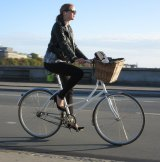 Chic cycling: a morning commuter on Queen Louise's Bridge in Copenhagen.