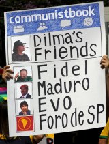 A demonstrator takes issue with Dilma Rousseff's friendly ties with left-wing Latin American governments.