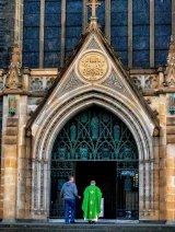 A priest at St Patrick's Cathedral on Sunday.