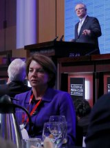 Anna Bligh listens as Treasurer Scott Morrison delivers his post-Budget address in the Great Hall at Parliament House.