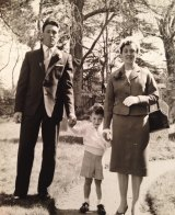 In his shadow: Cumming (centre) as a young boy with his parents Alex and Mary.
