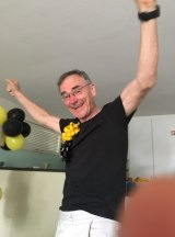 Greg Medcraft watching the Tigers win the AFL grand final.