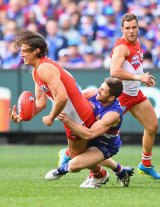 The indefatigable Dale Morris brings down Kurt Tippett in the grand final