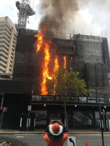 More than 60 firefighters battled the blaze at the building site in Circular Quay.