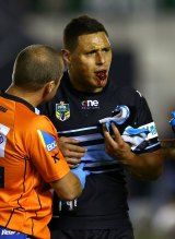 Injury: Sharks forward Anthony Tupou leaves the field with a broken jaw.