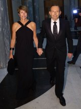 Breakfast with Prime Minister Tony Abbott, pictured with wife Margie at last year's ball, fetched $10,707.