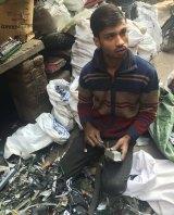 Imran Mansoori, sorting e-waste in Shastri Park, Delhi.
