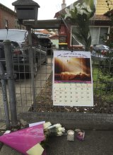 Flowers have been left at Andrew Chan's family home in Enfield.