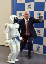 The PM with a humanoid robot during a visit to Japan in December.