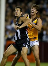 Stone played for Hawthorn, Collingwood and St Kilda during his AFL career. Here Collingwood's Chris Tarrant waits for the ball while being held by Stone.