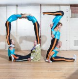 Circus Oz performers spell out a birthday message at the company's headquarters in Melbourne.