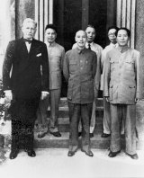 In this 1945 photo, China's Nationalist President Chiang Kai-shek, centre, and his Communist rival Mao Zedong, right, stand together with US ambassador to China Patrick Hurley in Chongqing, China.
