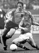 Cruyff, left, dodges the tackle from Sweden's Kent Karlsson during a World Cup soccer match  in 1974.