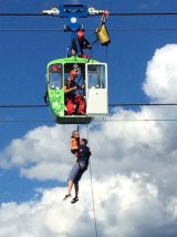 Firefighters rescue people from the a cable car gondola in Cologne, Germany, on Sunday.