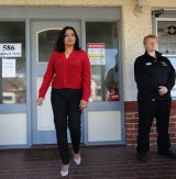 Dr Mehreen Faruqi leaves the Fertility Control Clinic in Albury, where a security guard is stationed.