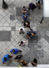 Queues at automated telling machines began snaking through Athens' streets at the weekend.