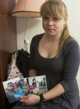 Anastasia Bubeyeva shows photos of her husband Andrei Bubeyev with her and their son.