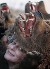 A girl poses with a bear fur during New Year ritual dances in Comanesti, 300 kilometres north of Bucharest, Romania.