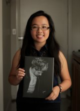 Nadia Hendryani holds a picture of One Direction's Niall Horan.