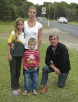 Caged in: Lindy Hudson with her children Emily and Tom, and deputy mayor of Eurobodalla Shire Council Rob Pollock,