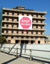 Stalled progress: the St Georges Hotel, on Beirut's Corniche, with its protest banner against Solidere.