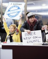 Hundreds of protestors crowded in the chambers and filled the empty seats of the sacked councillors.